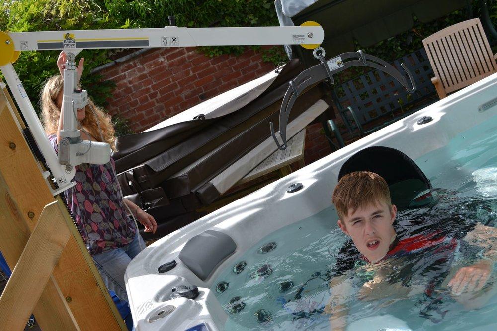 handi-move-wall-lift-access-hot-tub.jpg