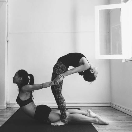 stock-photo-two-young-women-doing-yoga-asana-warrior-one-pose-virabhadrasana-partner-yoga-443889901.jpg