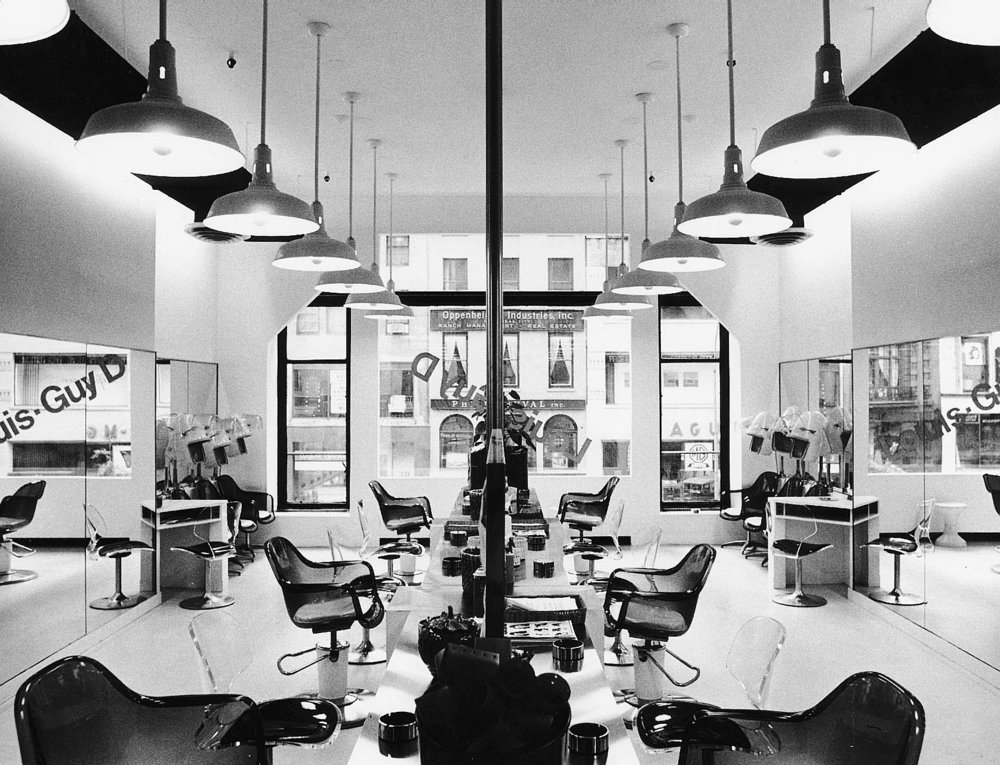 "LOUIS GUY'D SALON, NYC   The beauty parlor was designed to fit into an existing ""L"" shaped space on the second floor of a midtown office building. The layout was dictated by both the existing entry location and the necessary circulation pattern through the various work stations."