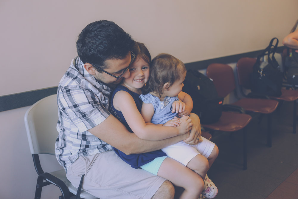 Family photo in the waiting room at Premier Pediatrics, Staten Island, NY, Documentary Photography
