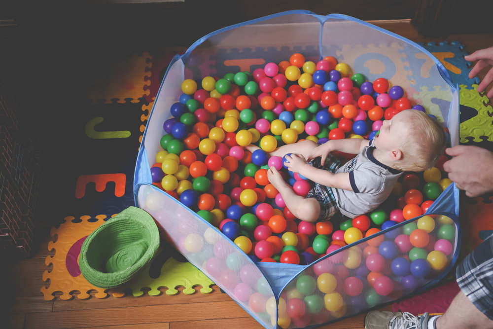 Playing in the ball pit, family photography, Rutherford, NJ