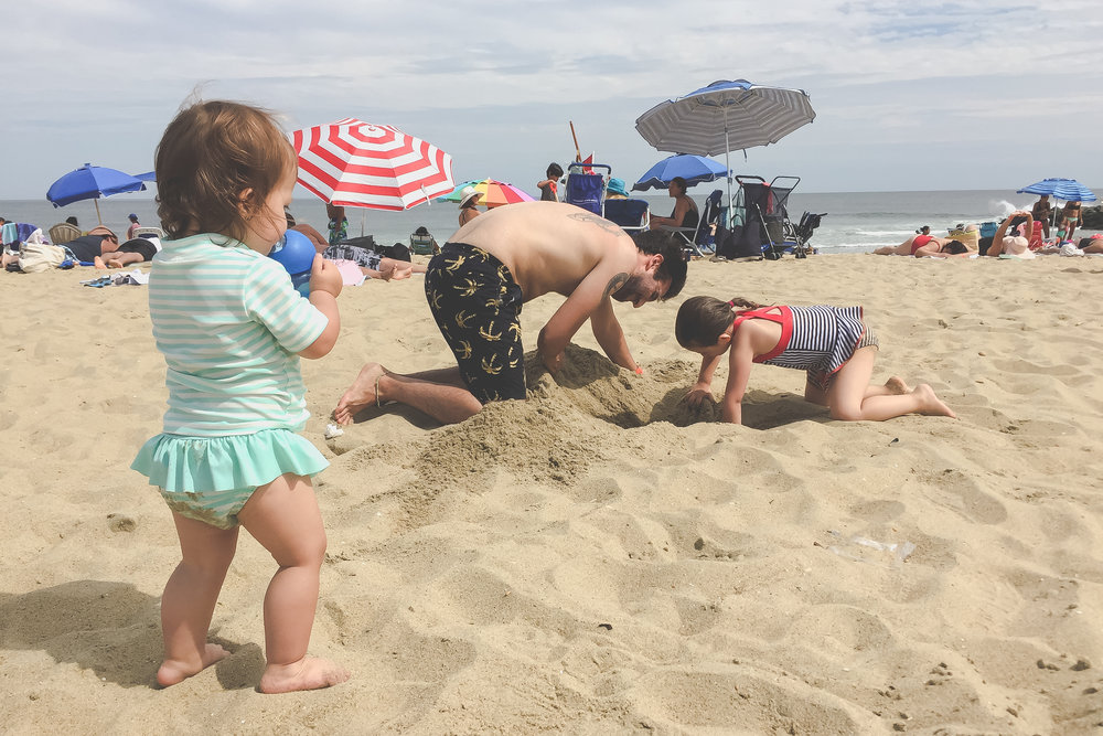 Digging a hole in the sand at Asbury Park, NJ | Documentary Family Photography | Staten Island, NY