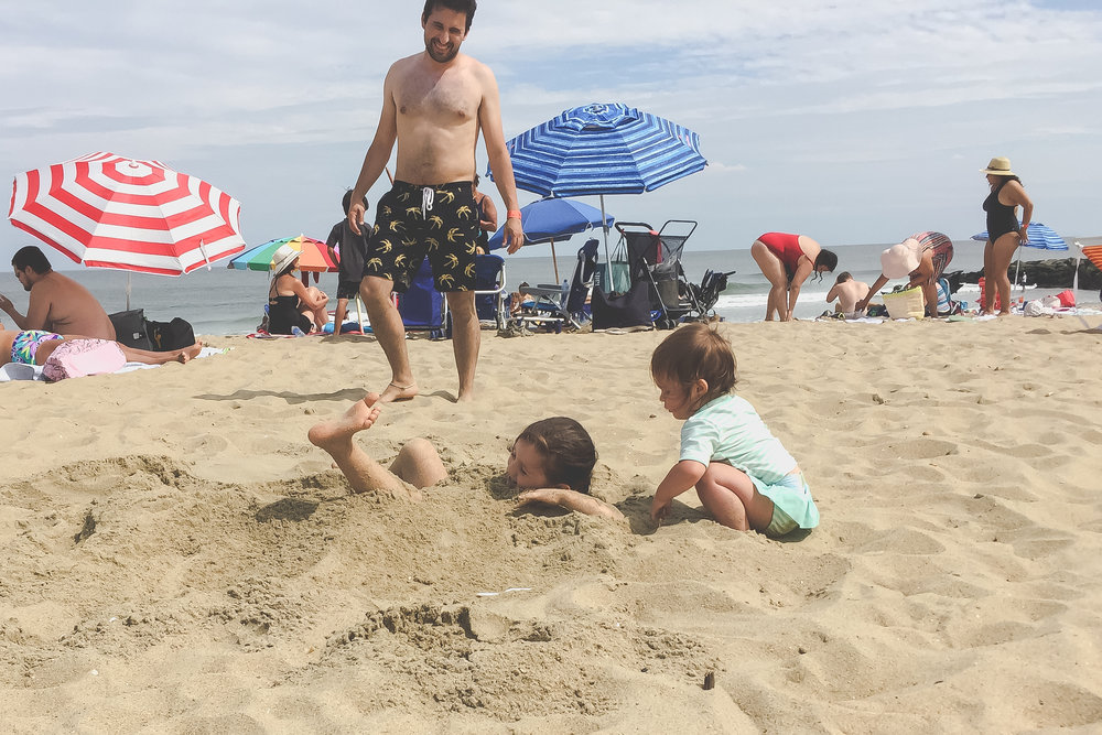 Getting buried in the sand at the beach in Asbury Park, NJ | Documentary Family Photography | Staten Island, New York