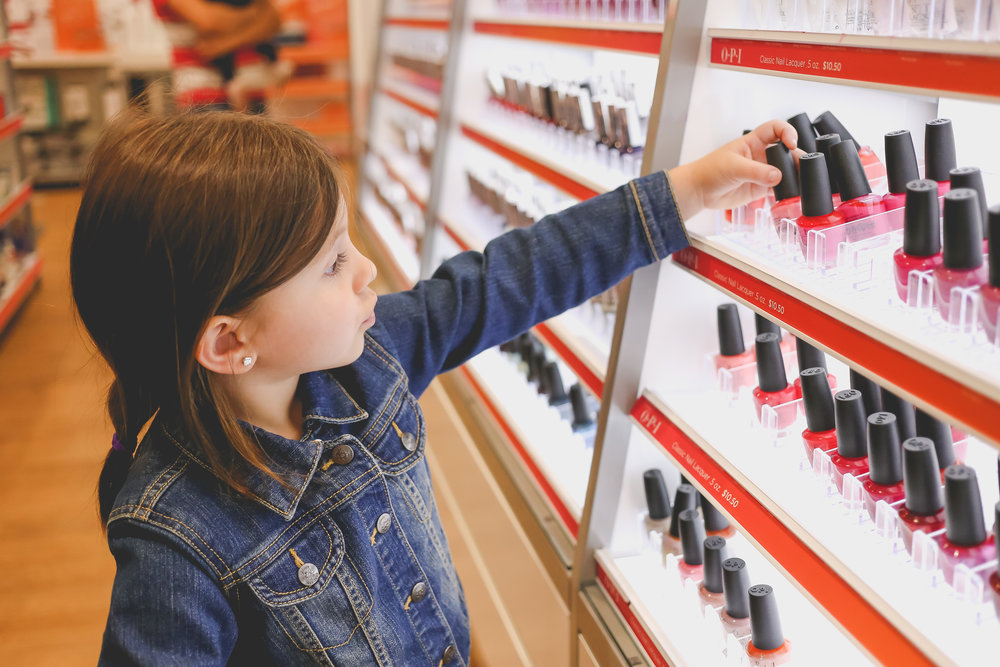 Little girl shopping for nail polish at Ulta beauty supply in Staten Island, NY. Day in the Life Family Photography.