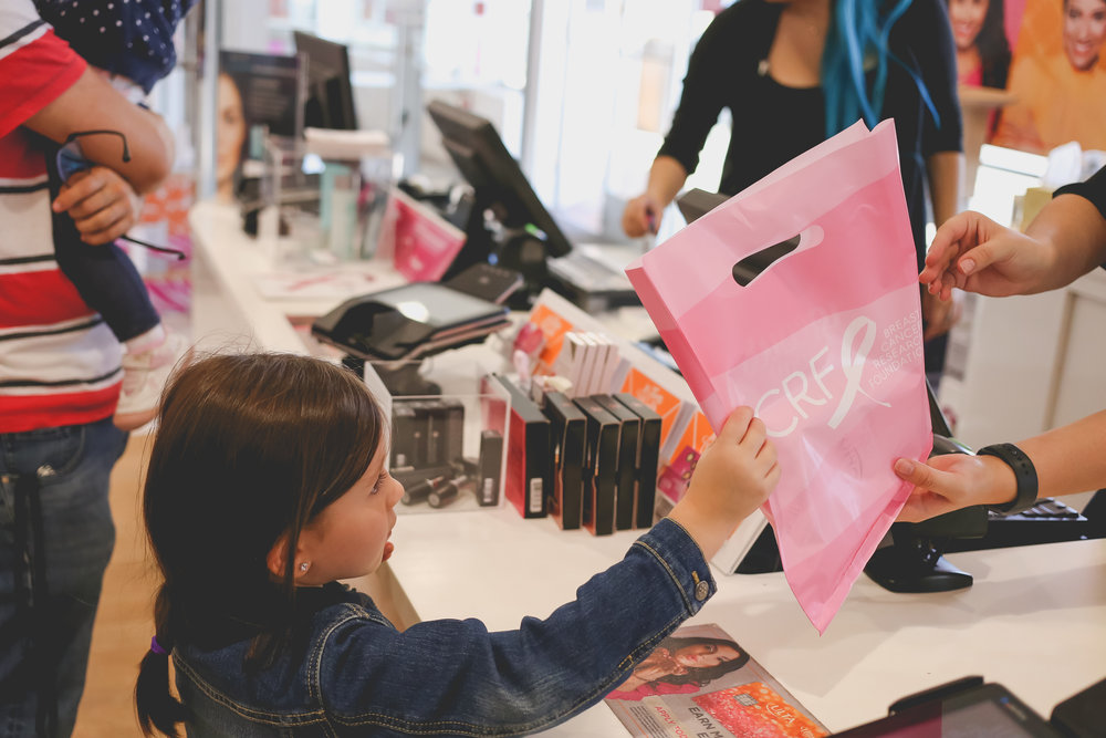 Girl accepting her purchase at Ulta beauty supply store in Staten Island. Family photojournalism.