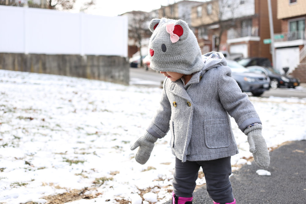 Girl out for a walk in the winter. Lehigh Valley documentary family photography sessions.