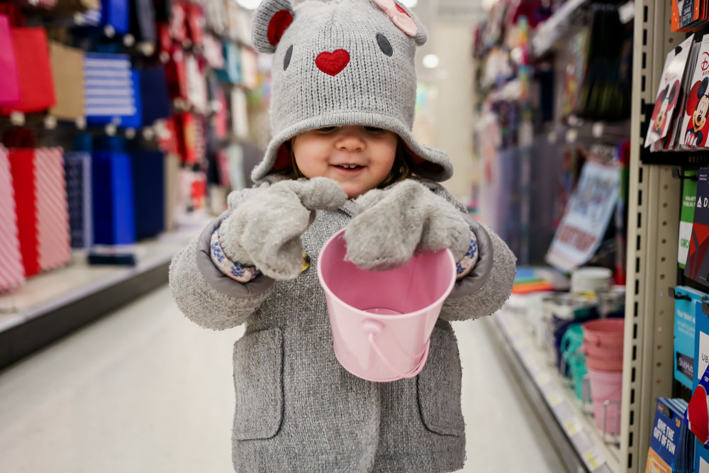 Young girl with pink bucket at Target.