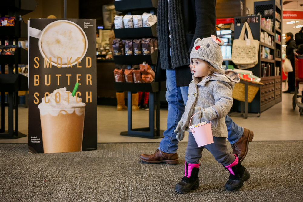 Two year old girl leaving Target with dad in front of Starbucks. On location family photography sessions by Jen Grima, Macungie, PA photographer.