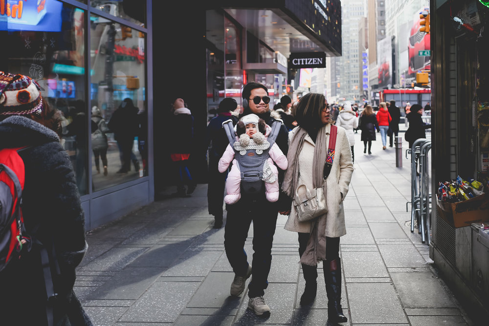 Walking through midtown Manhattan, NYC family photography.