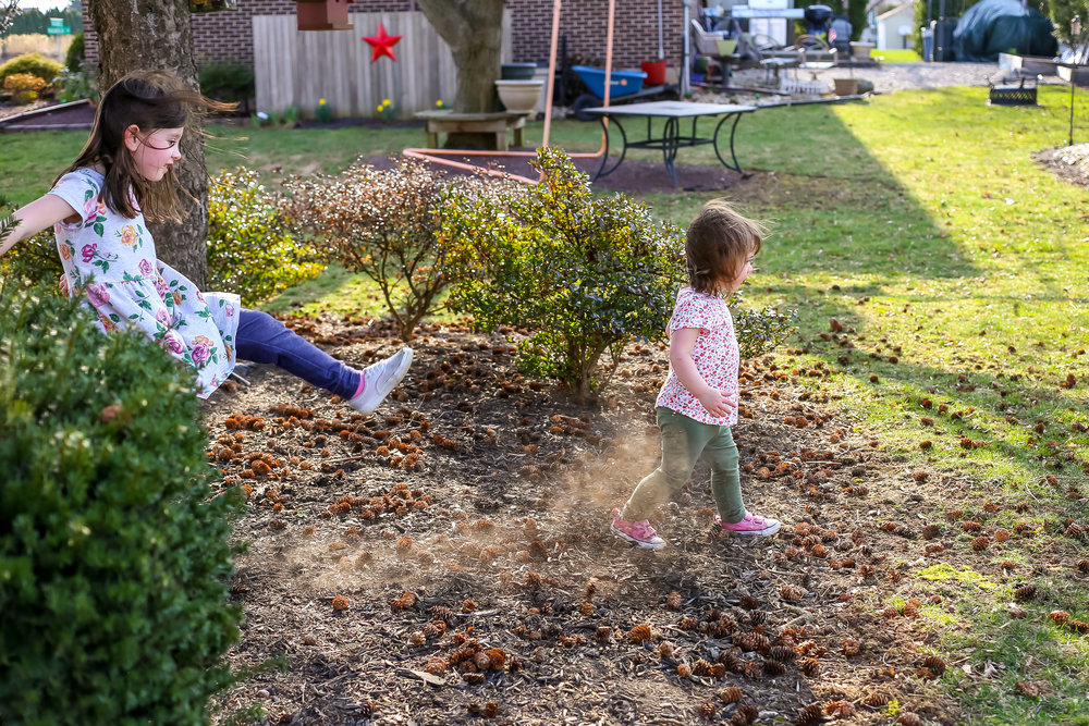 Young girl kicking the dirt during a family photo session in Lehigh Valley, PA.