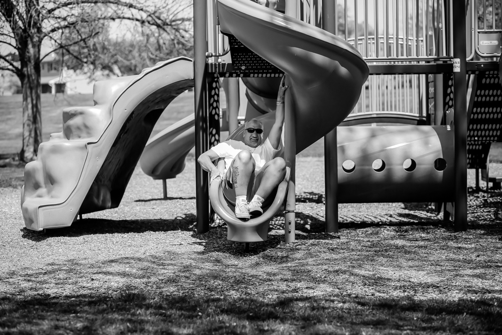 Grandfather on the slide at the playground in Macungie, PA.