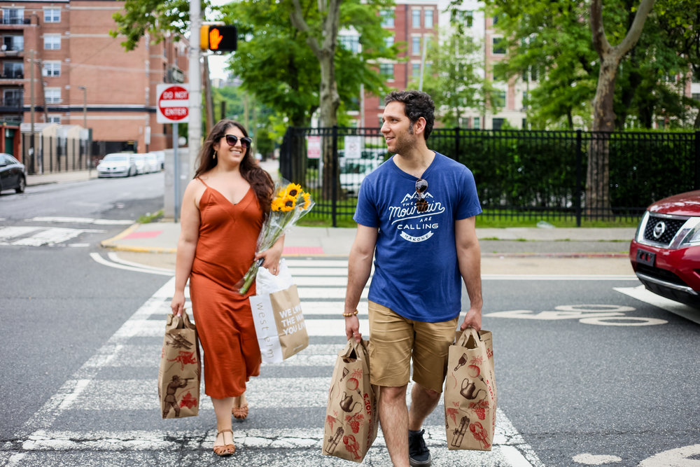 Walking home from the grocery store in Hoboken, NJ during a candid, day in the life engagement session.