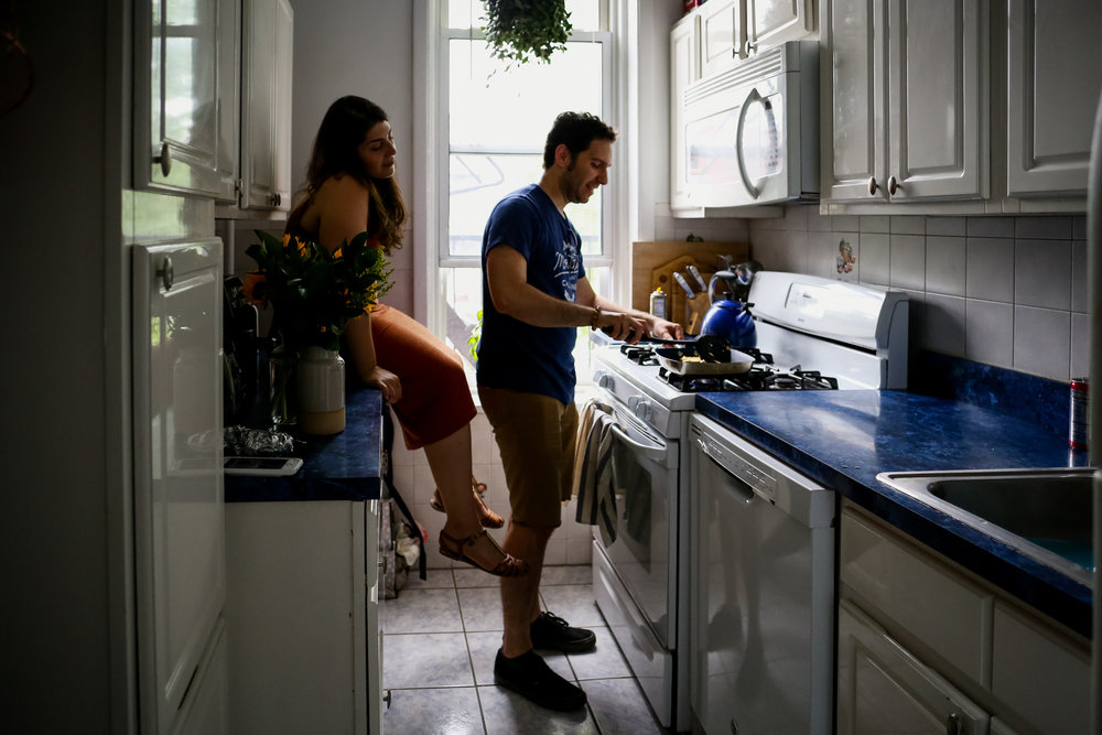 Cooking together during an at home engagement session in Hoboken, NJ.