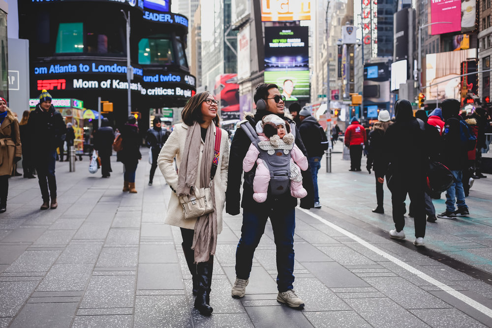 Young family in Times Square during a New York City Vacation Session with photographer Jen Grima.