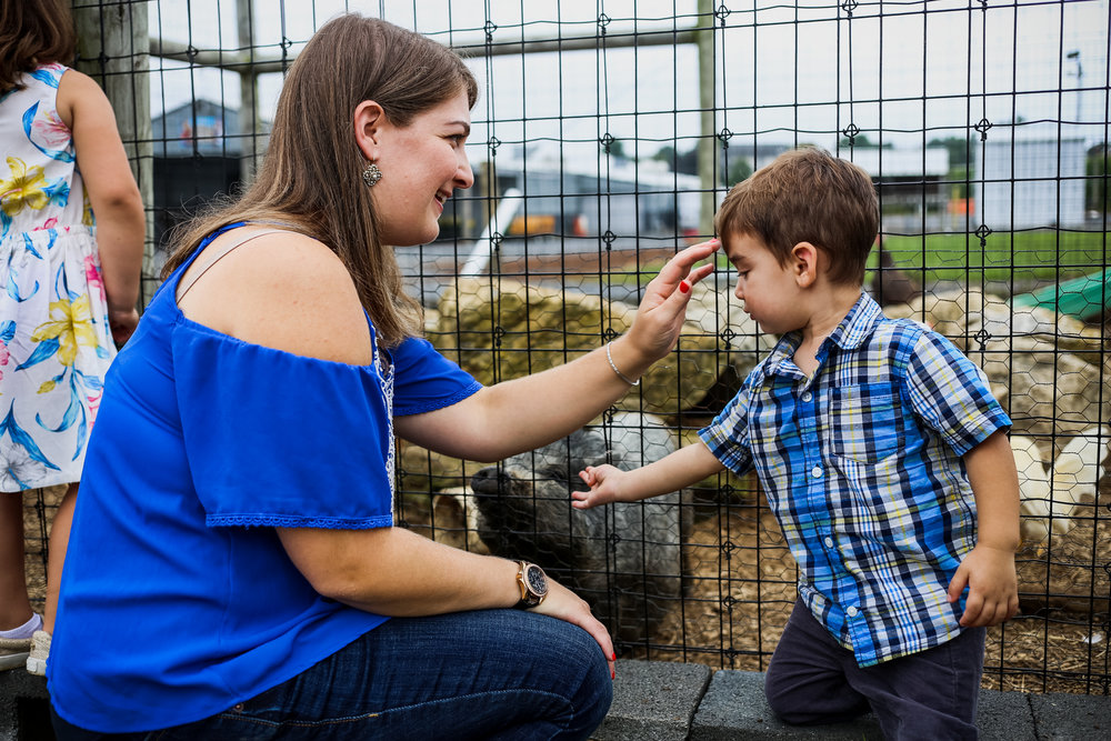 Sweet mother and son moment while visiting the farm animals at Grim's Orchard in Lehigh Valley, PA.