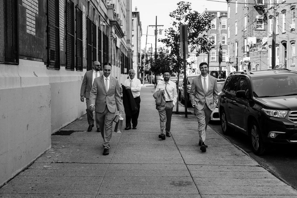 Groomsman walking toward the ceremony, photo by Jen Grima, Lehigh Valley Wedding Photographer.
