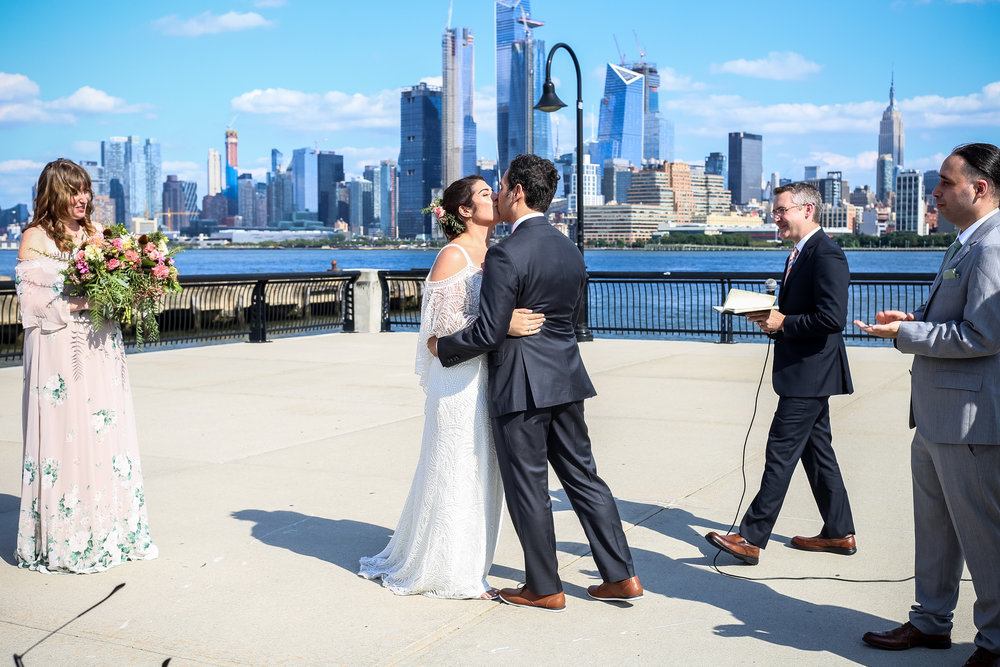 First kiss for the bride and groom, Lehigh Valley documentary wedding photographer.