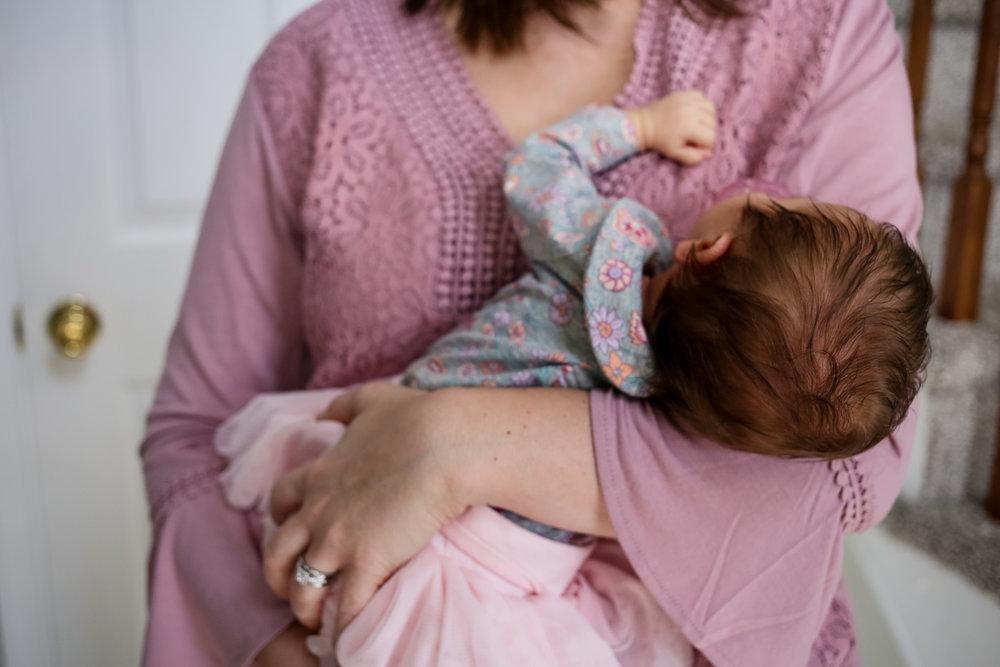 Mother holding her newborn baby girl.