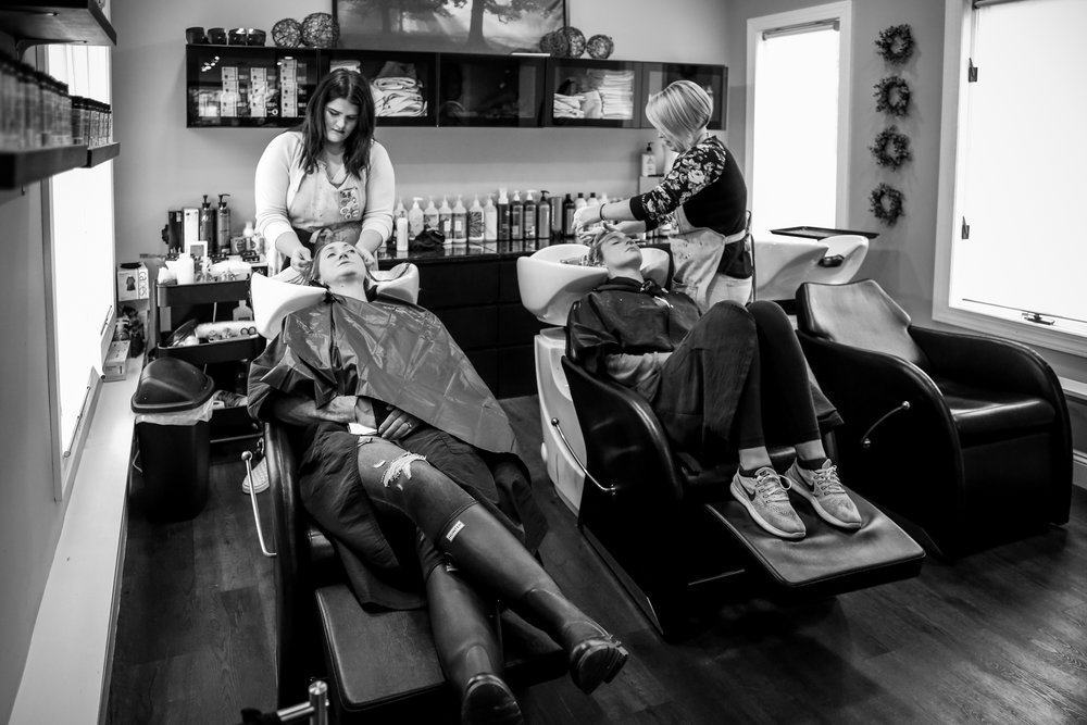 Girls getting their hair washed at Rooted Salon in Allentown, PA.