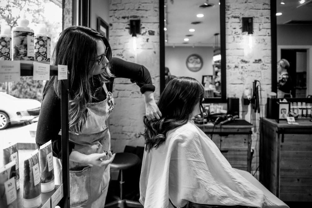 Stylist giving a haircut during a small business branding session in Allentown, Pennsylvania.