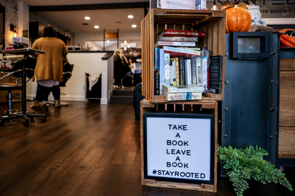 Take a book, leave a book - documenting the charm of a small business with a personalized branding session at Rooted Salon in Lehigh Valley, PA.