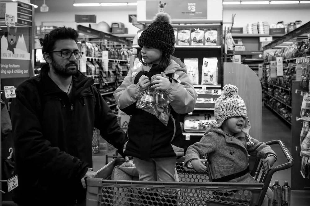 Father and his two daughter's shopping at PetSmart in Trexlertown, PA.