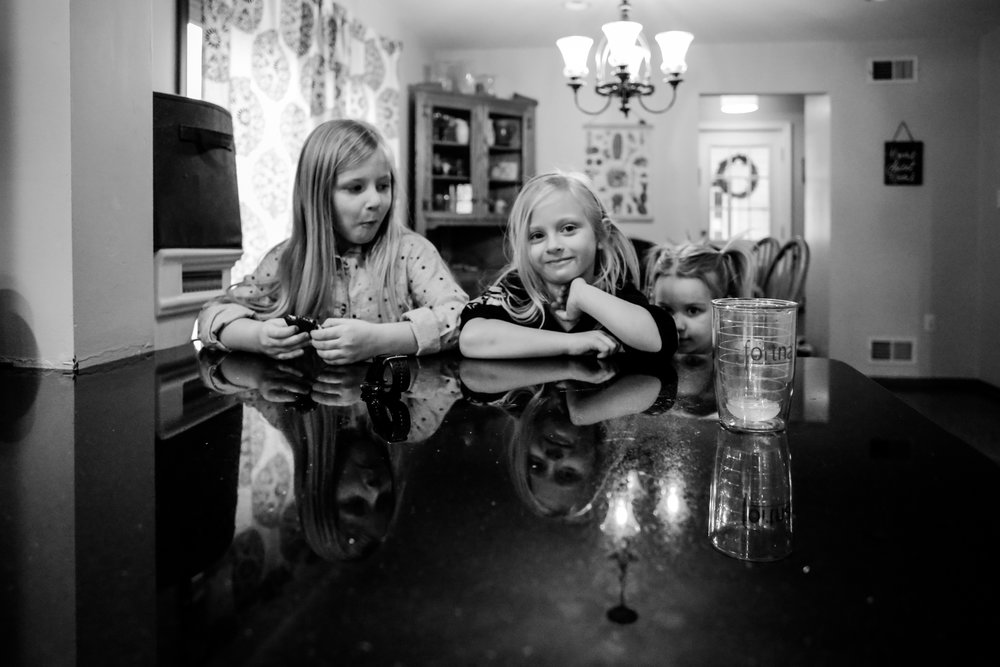 Sisters hanging out in the kitchen during their at home family photography session in Fogelsville, PA.