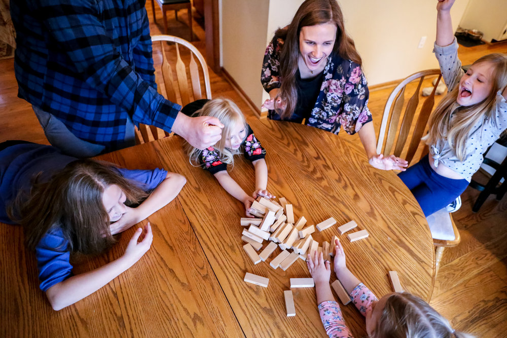 Quality family game time during a family photo session with Jen Grima in Fogelsville, PA.