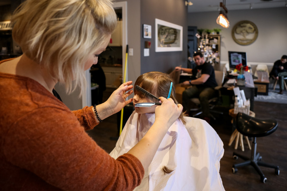 Little girl getting a haircut for her third birthday with Katelyn at Rooted Salon in Allentown, Pennsylvania.