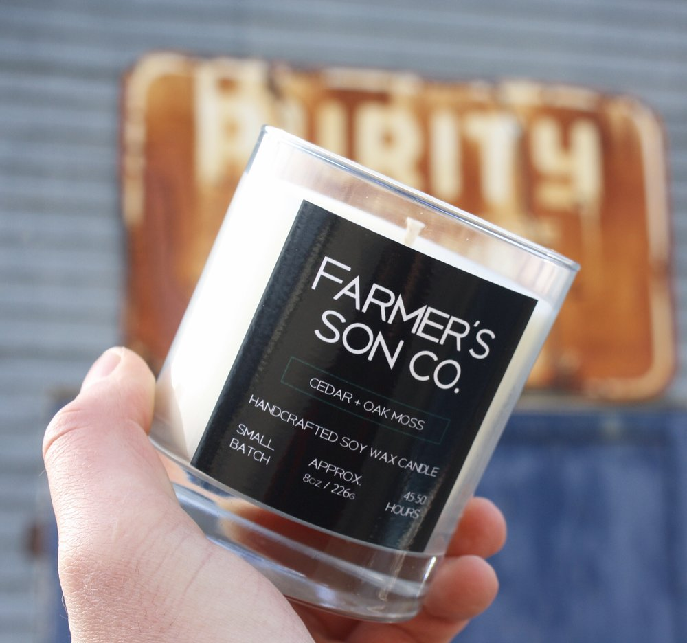 CEDAR + OAK MOSS The scent of damp leaves underfoot, the spice of cedar and the fragrant notes of the mighty pines as you embark on journey through the woods. Inspired by the dense and vast forests of northern Manitoba The Farmer's Son Co. Cedar + Oak Moss candle will instantly take you back to that last fall hike with it's calming, fresh and ambient scent