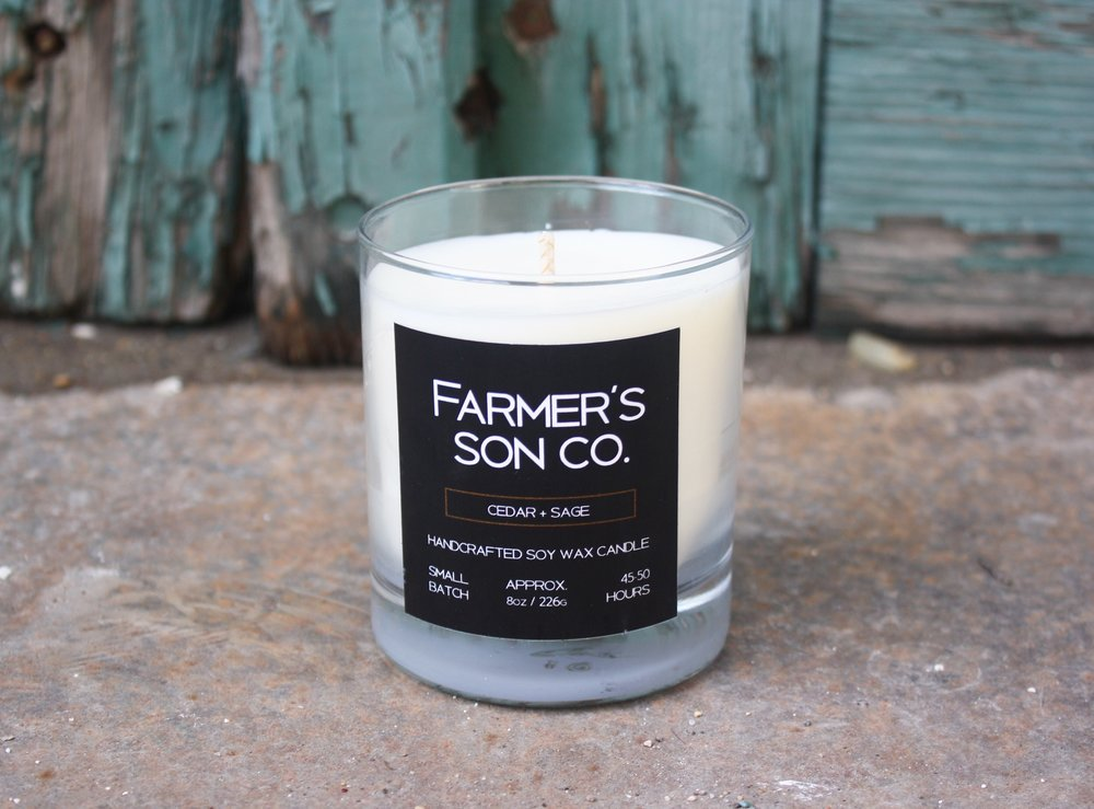 CEDAR + SAGE The Farmer's Son Co. Cedar + Sage candle is a woodsy & manly scent that will evoke memories of long weekend hikes through the forest, your favourite pooch by your side It brings to mind the scent of dew damp needles, a fine mist of rain coming down and the earthy, herbaceous scent of sage