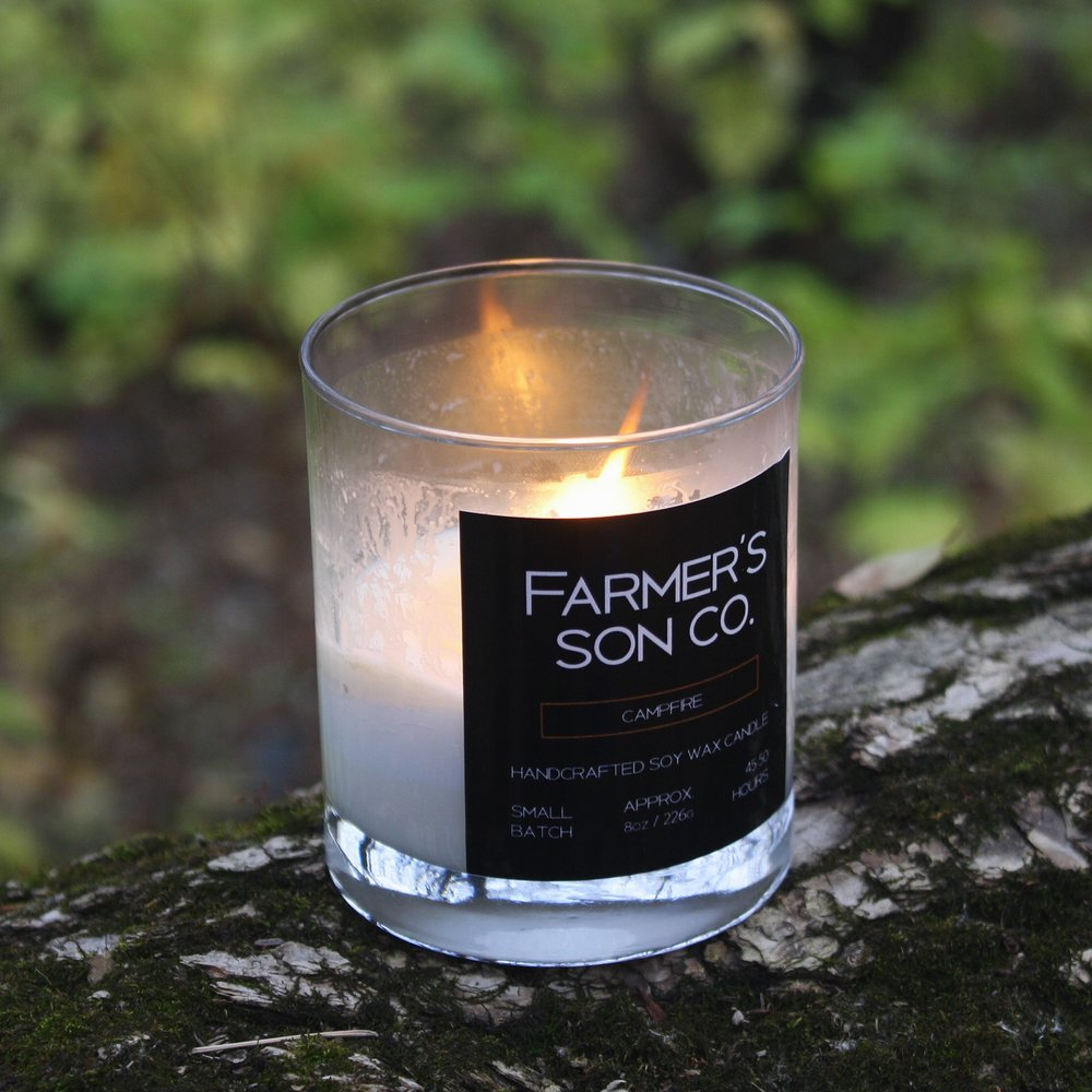 CAMPFIRE The Farmer's Son Co. signature Campfire candle captures those memories of past camping trips. Of those nights where the fire is rumbling, the conversation flows among friends as the world's problems are being solved after a few beers