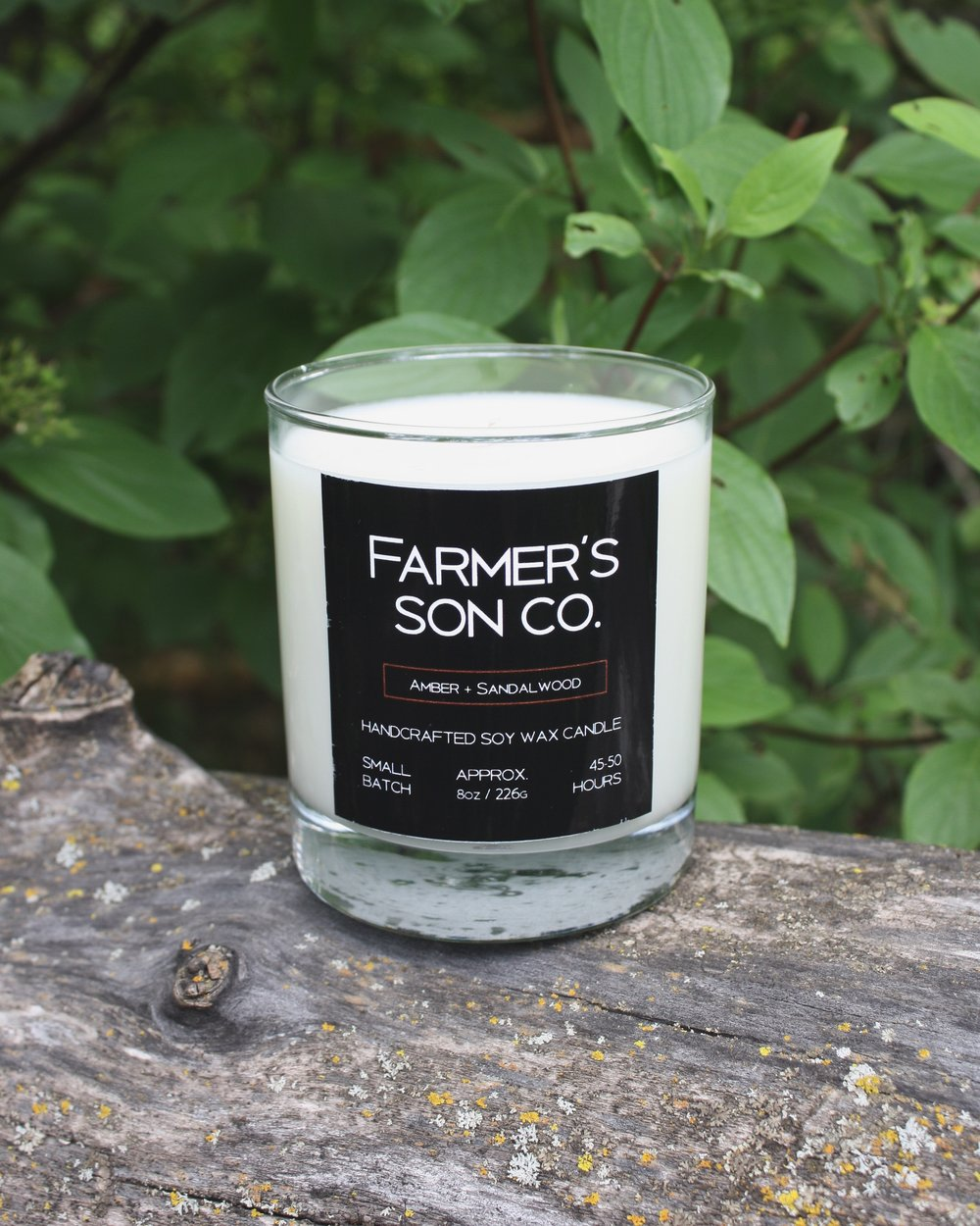 AMBER + SANDALWOOD The Farmer's Son Co. Amber + Sandalwood is inspired by the farmer's son's travels. Dark and woodsy notes of sandalwood, musky, smoky and exotic amber. Spicy and earthy, an inviting scent for those long summer nights