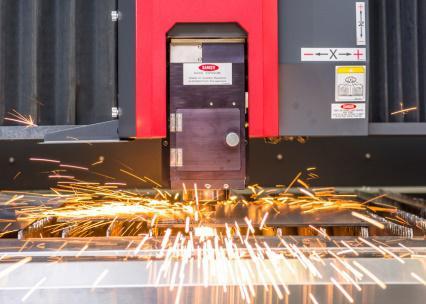 Laser machine head in action in precision machining