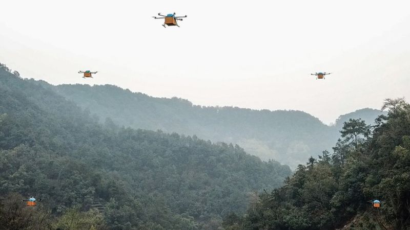 A fleet of drones transport tea leaves over mountainous Zhejiang Province in China