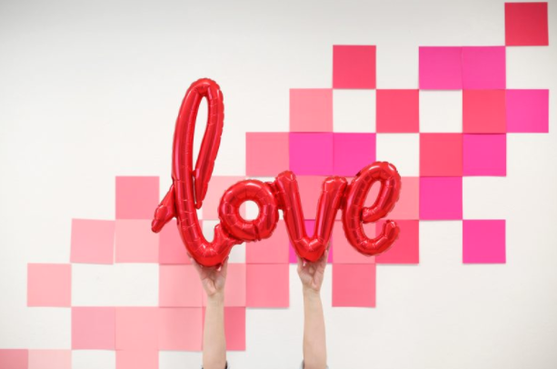 SQUARE PHOTO BACKDROP - Source: Lovely IndeedWe've already said how much we love custom photo backdrops for our photoshoots, and this super easy square photo backdrop is perfect for any brief! With 3 materials and 10 minutes to create, make this a priority for your next Valentine's shoot. Pro tip? Use this DIY with different colours to match any theme or holiday.