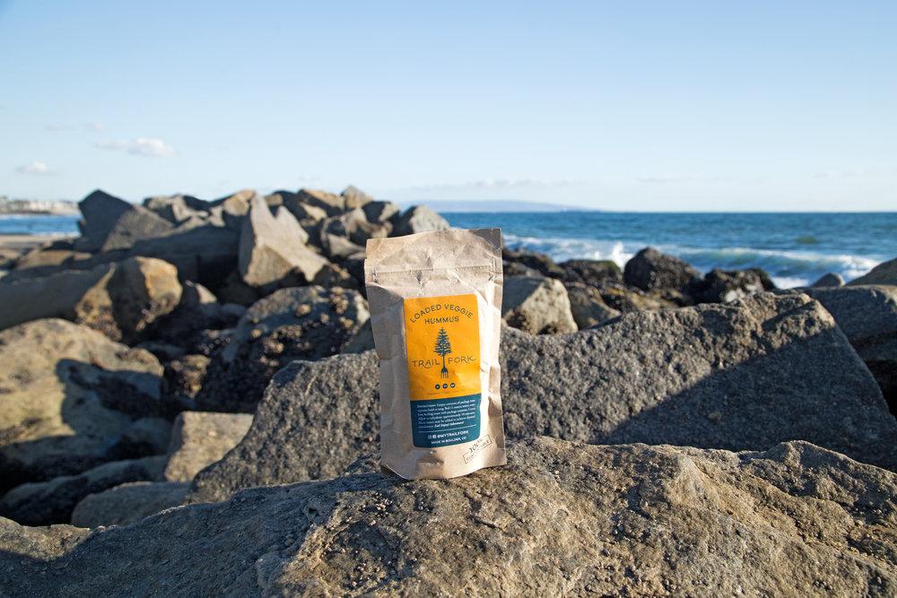 loaded-veggie-hummus-rocks-ocean (1).jpg