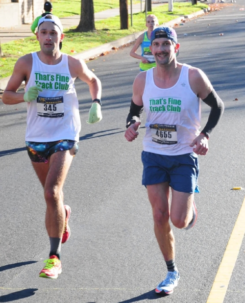 Doug running with John Williams to massive personal bests at CIM 2017. Photo:  TFTC .