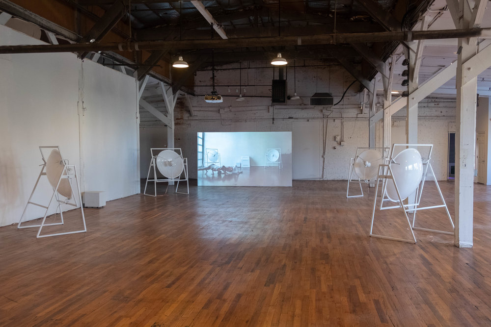 Installation image of  guncotton  (2018), mixed media sound installation;  The Judo of Cold Combustion  (2018), video. Image by Sarah-Anne Wagoner. Courtesy of Stove Works.