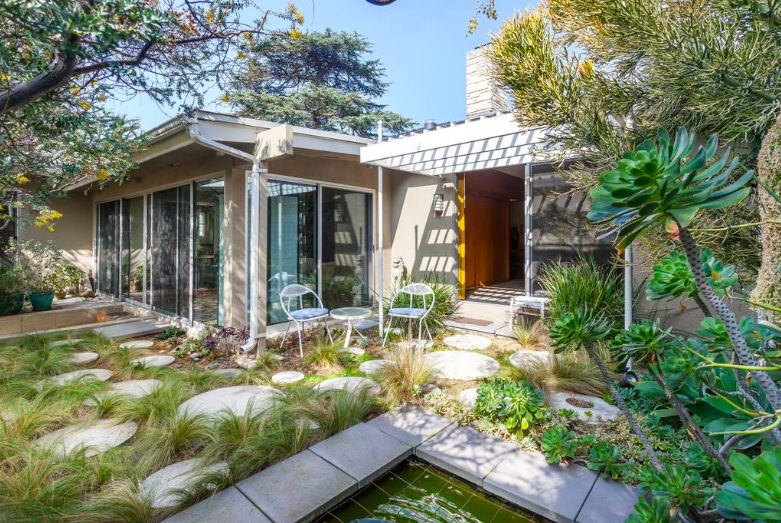 Los Feliz Oasis - A stunning 2,700 sq. ft. mid century home with a massive swimming pool and 180 degree views.
