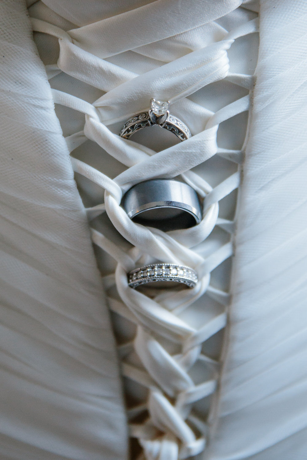 a very unique bridal dress and rings