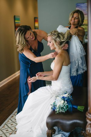 bridesmaids helping a bride get ready