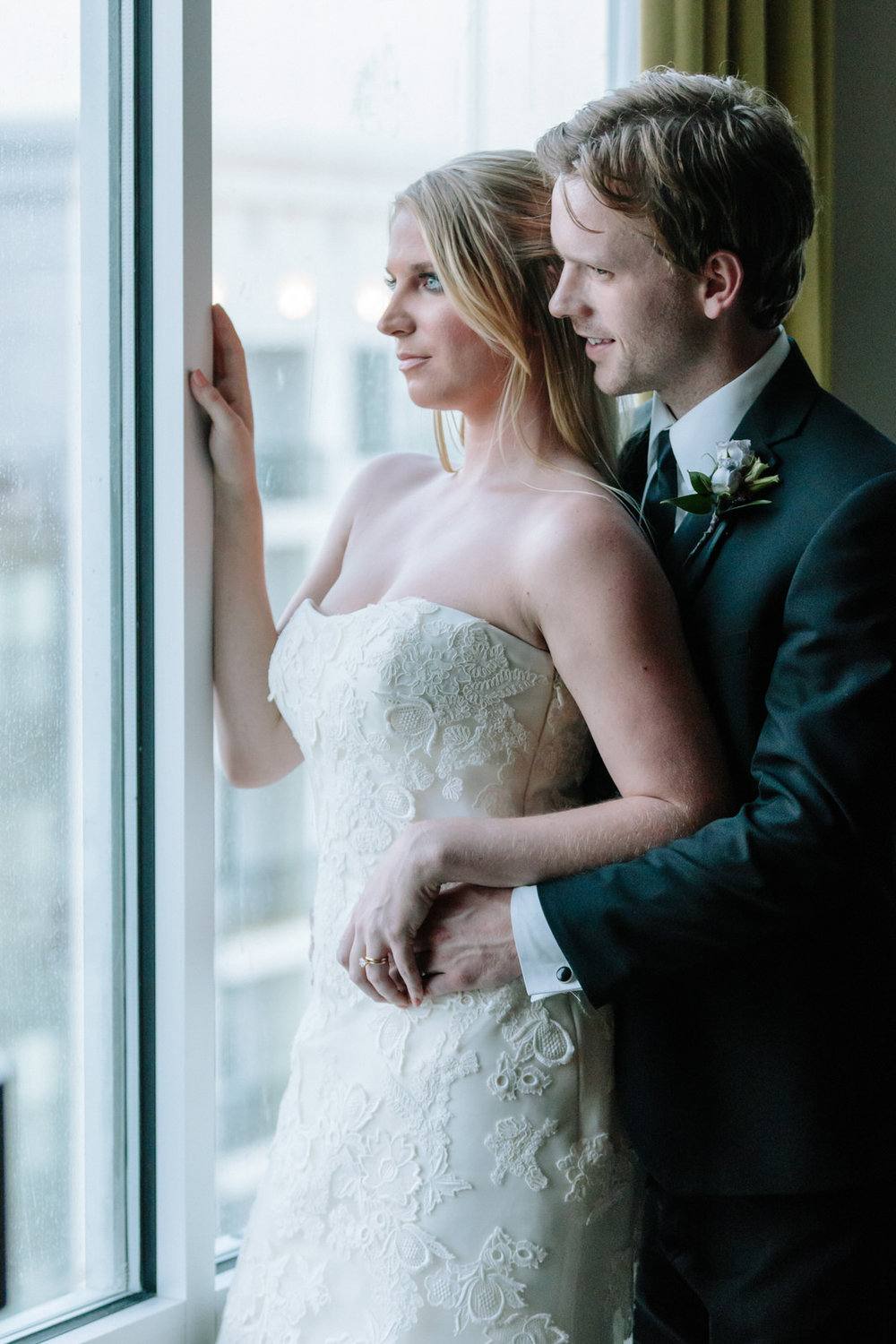 bride and groom enjoy the urban view