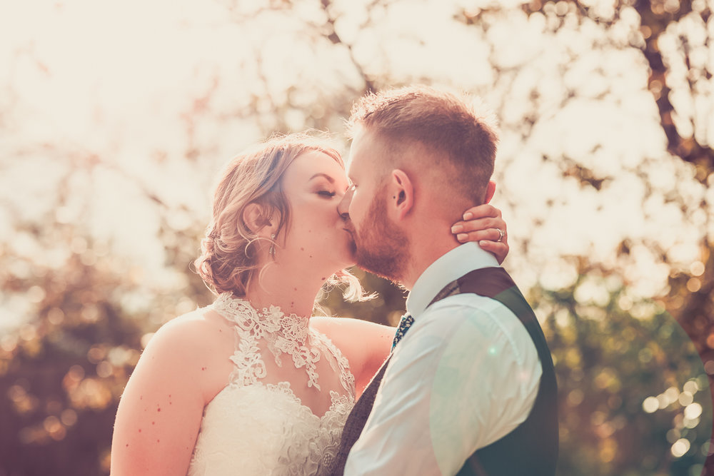 Bride and groom kissing on their wedding day at The Wroxeter Hotel, Shrewsbury