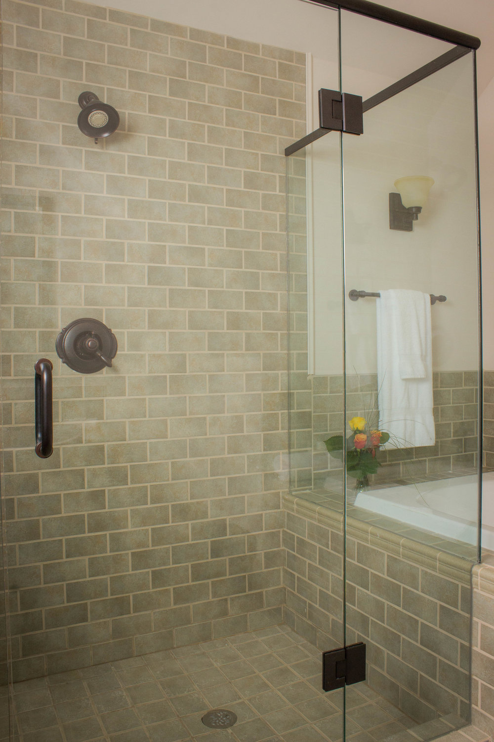 Extensive glass shower enclosures in bathrooms
