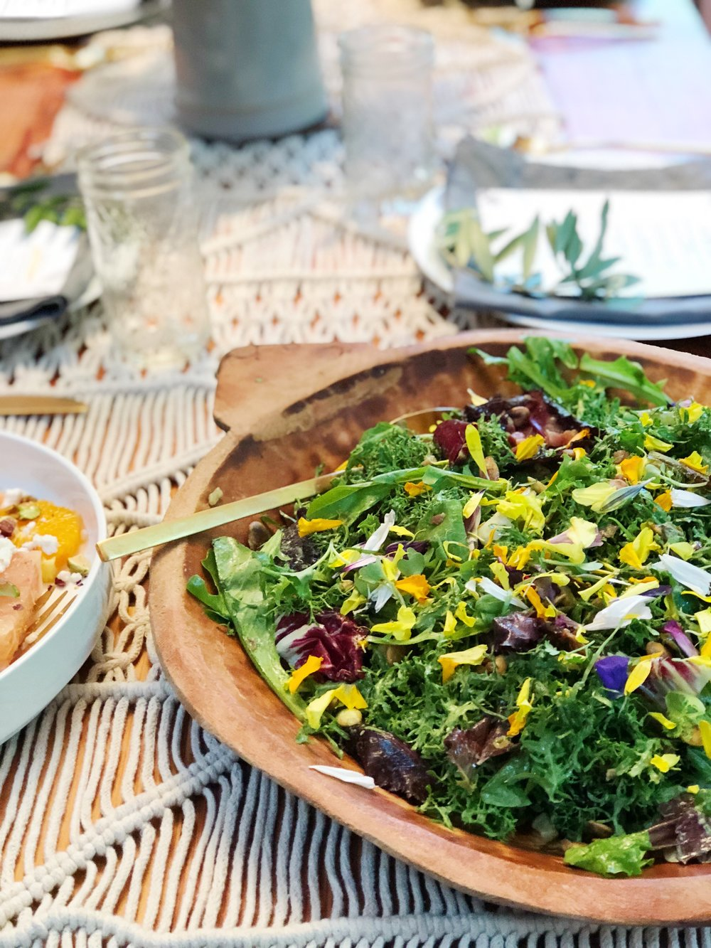 Spicy Mustard Green Salad with Paprika Spiced Pancetta, Toasted Pumpkin Seeds, Tossed with Green Vegan Buttermilk Dressing and Garnished with Edible Flowers