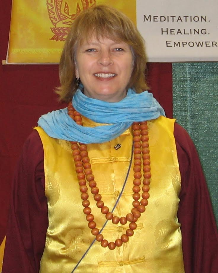 Charlotte M. Steen, Vajracharya ZhiChan, is an ordained Chinese Esoteric (Hanmi) Buddhist teacher and Sifu, founder of the Upper Midwest Hanmi Buddhist Association, dedicated to serving all those who have open hearts-minds through Chinese Esoteric Buddhist spiritual healing services, meditation classes and prayer services. Originally from Minnesota and trained as a high school English teacher, Sifu Steen's spiritual life grew a new branch in April 2002 when she met her Guru, Mahavairocana Golden Crown Dharma King Dechan Jueren and received her first Hanmi Buddhist meditation practice from him in Mount Shasta, CA. In June of 2002 she received the Hanmi Buddhist Five Foundations for Self-Realization meditations, becoming a formal initiate to the lineage and student of Great Master Dechan Jueren's in September 2002 in Amherst, MA. In April 2003 she received the Medicine Buddha Dharma and the Black Manjusri Dharma practices from Great Master Dechan Jueren in Amherst, MA. Sifu Steen was blessed to spend 2004-2008 in China continuing her Buddhist studies and practice while learning Mandarin Chinese and acting as one of the American Ambassadors for the World Buddhist Hanmi Association. Afterwards, she served for four years as a full-time volunteer for Great Master Dechan Jueren's Dari Rulai Temple in Los Angeles, CA, including two years as Vice Abbot. In November 2010 she received her formal ordination and yellow vest as a teacher and Sifu of the Hanmi Buddhist lineage from Mahavairocana Golden Crown Dharma King Dechan Jueren at Ying Tian Temple, Chengdu, Sichuan Province, China. Sifu Steen returned in 2012 to Minnesota to be closer to her family and to offer those in the Midwest the opportunity to learn and to practice Chinese Esoteric Buddhist meditations.
