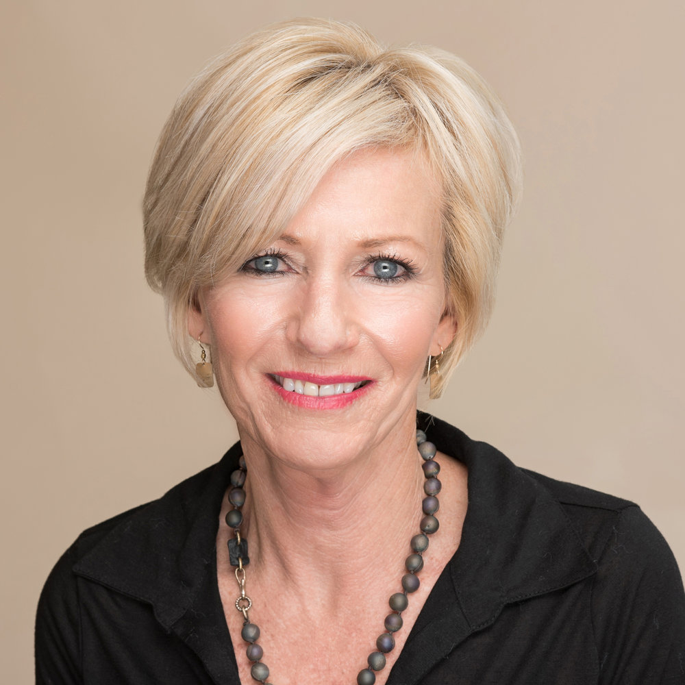 Short haired smiling woman in a black blouse