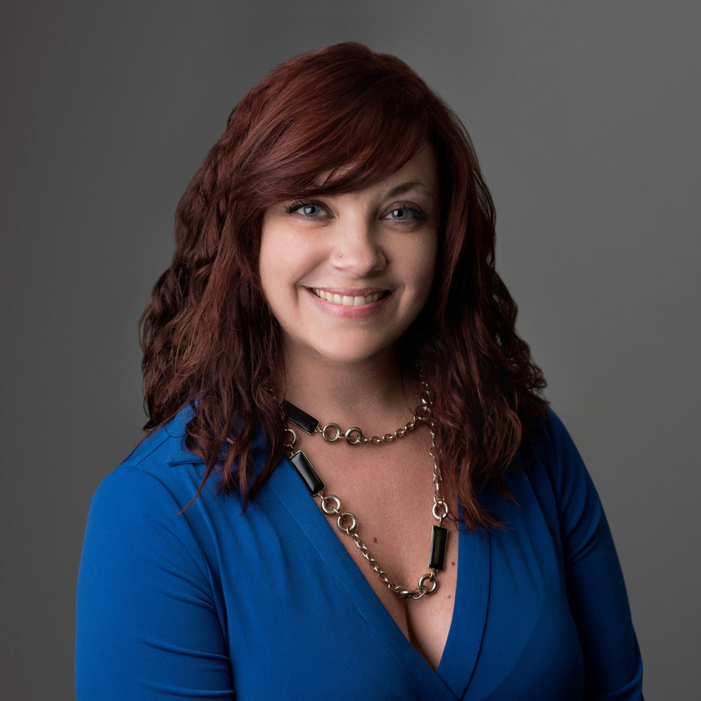 Professional business headshot of a woman using studio light