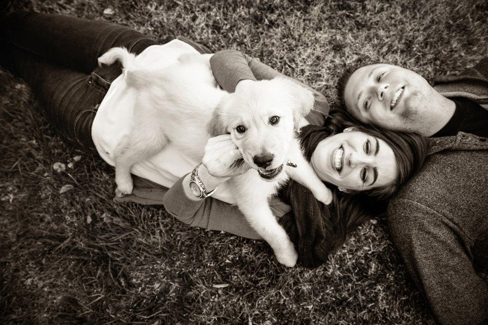 Black and white image of a couple with their dog